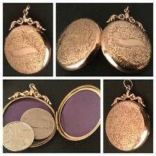 A LARGE FOLIATE ENGRAVED 9CT ROSE GOLD FANCY ROUND LOCKET VICTORIAN  CIRCA 1900