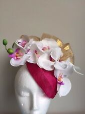 Pink air hostess fascinator with gold silk abaca loops and white orchards.