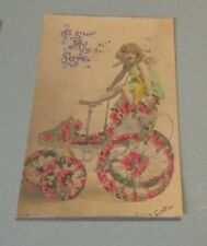 1908 Girl on Motorized Buggy With Flowers Greet My Love Valentine's Day Postcard
