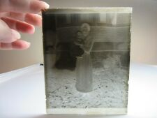 Vtg glass negative photo slide. Black & white. Mother holding baby outside