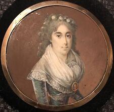 portrait miniature de femme portant un portrait miniature d'officier vers 1790