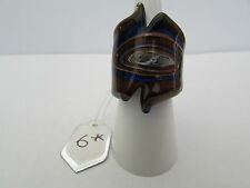 A RED,BLUE & COPPER SWIRLING MURANO STYLE GLASS RING. SIZE L.   (6*)