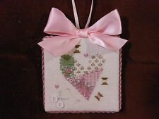 Completed finished Love cross stitch ornament