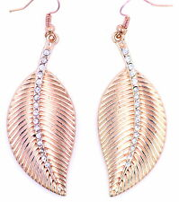 Rosy gold tone leaf dangle earrings with crystal