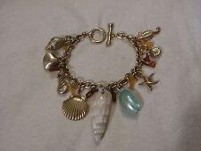 ..Gold Tone,Mother Of Pearl,Seashell Sea Theme Charms Bracelet,Seahorse,Starfish