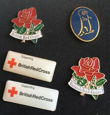 Assorted enamelled Lapel Pins by DUCHAMP of London. Red Cross and Otter Brewery.
