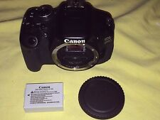 Canon T3i/600D Digital SLR Camera Body Only + Battery Pack + Neck Strap Bundle