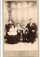 cabinet photo of handsome family in Detroit Mi. Two boys w/ ruffled collars
