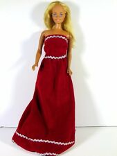 DRESSED BARBIE DOLL IN RED AND SILVER GOWN