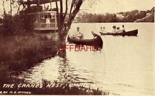 THE CRANE'S NEST, OMRO, WI 1912 dog and man in canoe. Houseboat on Fox River