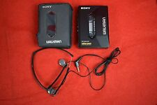 Vintage Sony Walkman WM-2091 cassette player with MDR-A10 headphones and case