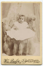 CABINET CARD BABY ON FUR RUG IN WICKER CHAIR. COLUMBIA, PA.