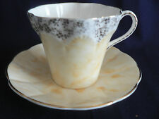 ELIZABETHAN YELLOW  FLUTED GOLD TRIMMED TEA CUP AND SAUCER