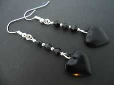 A PAIR OF DANGLY BLACK HEART SILVER PLATED EARRINGS.