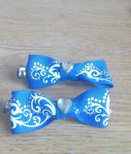 2 x Hand -made blue swirl patterned bow hair clips -