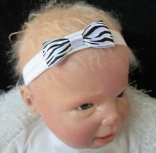 Baby Girl White Headband with Small Zebra Print Bow