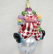 Figural Blown Glass Clown Ornament Sitting on Ball with Moons and Stars