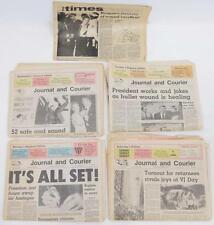 Five 1981 newspapers recounting reagan failed assassination and freed... Lot 350