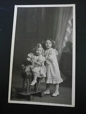 Real Photographic Postcard of 2 Children, HAIRY ROCKING HORSE