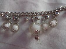 BRAND  NEW  FASHONABLE SILVER PLATED WITH CLEAR AND WHITE BALL CHARMS BRACELET.