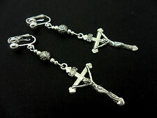 A PAIR OF SILVER  CROSS CRUCIFIX DANGLY CLIP ON  EARRINGS. NEW.