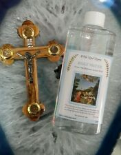 Blessed Holy water from the Jordan river and olive wood cross from Jerusalem