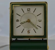 w355       Le-Coultre hand wined vintage gold plate & green enamel alarm clock.