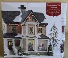 st nicholas square village Decorating the Tree New in Box