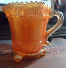 CARNIVAL GLASS CREAM JUG MARIGOLD COLOUR,ON 3 FEET. 8.5 CM TALL VERY GOOD.