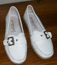 Pair of white moccasin style slip on shoes by Cushion-Walk.  Size 6