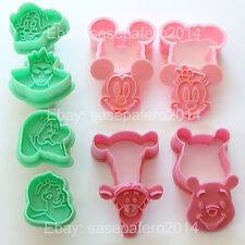 Disney cookie cutters Mickey, Minnie Mouse, Snow White, Dwarfs, Pooh, Tigger.