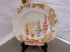 1948 + ROSINA CHINA  ALMOST SQUARE SIDE PLATE WITH A ?HOLLYHOCK PATTERN