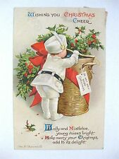 Ellen Clapsaddle Christmas Pc: Boy in White Opening Lg Basket of Gifts