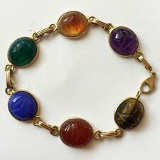 14 kt yellow gold lobster clasp bracelet with bezel set carved scarab. Lot 12B