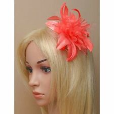 Ladies coral red flower fascinator with feather tendrils