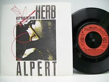 "7"" VINYL SINGLE. Keep Your Eye On Me b/w Our Song by Herb Alpert. 1987. USA 602."