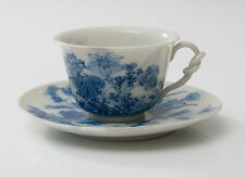 A Chinese Porcelain Blue & White Painted Cup and Saucer with Knotted Handle