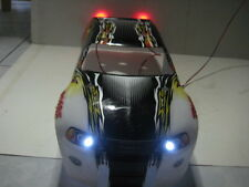 TRAXXAS T-MAXX 2.5 OR 3.3 PROGRAPHIY BODY WITH  BUILT IN LED LIGHTS
