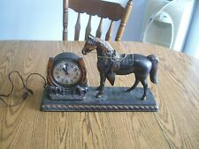 brass or bronze horse with saddle electric sessions clock mantle  not working