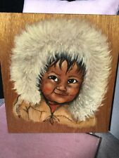 Inuit Eskimo Painting On Wood Depicting a Smiling Young Boy Wearing a Fur Hat