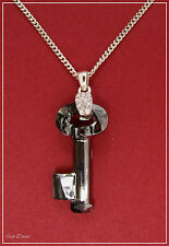 JON RICHARD. SMOKY GREY SWAROVSKI CRYSTAL KEY NECKLACE. TICKET PRICE £50 (BD)