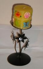 Black Candle Holder With Decorative Candle.