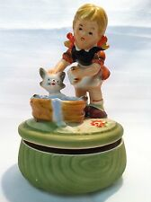 """Music box girl with pigtails giving cat a bath plays """"Talking to the animals"""""""