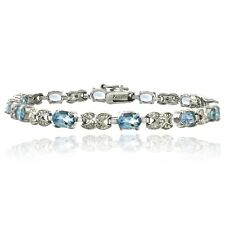 7ct Blue Topaz & Diamond Accent X & Oval Bracelet in Brass