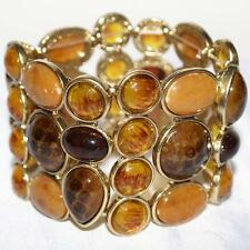 Bracelet - Stretch Cuff Bracelet in Antique Gold Metal with Amber Tone Stones