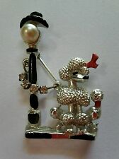 Poodle standing by a lamp post brooch