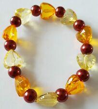NUOVO fatto a mano con elastico elastico Arancio Giallo E Rosso Bracciale Con Perline Cuore.