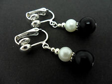 A PAIR OF DANGLY BLACK & WHITE GLASS PEARL  SILVER PLATED CLIP ON   EARRINGS.