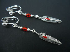 A PAIR OF  TIBETAN SILVER RED CRYSTAL FEATHER THEMED  CLIP ON EARRINGS. NEW.