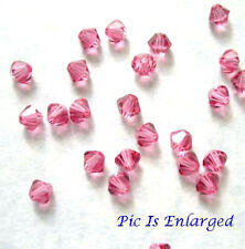 24 ROSE SWAROVSKI CRYSTAL # 5301 BICONE BEADS 4MM